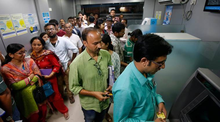People wait to withdraw and deposit their money at an ATM kiosk in Kolkata, India, November 8, 2016. REUTERS/Rupak De Chowdhuri