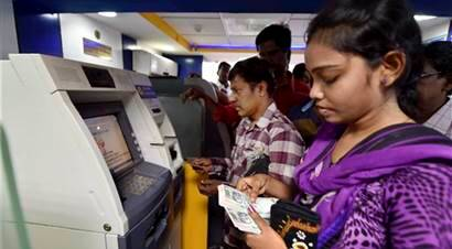 Demonetisation: Queues go longer at ATMs, banks, chaos reigns