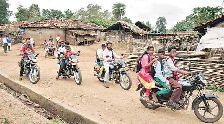 Padaboria village residents riding on their newly-bought bikes. (Express Photo: Deepak Daware)