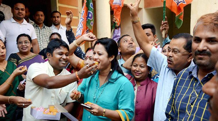 Guwahati: Bharatiya Janata Party (BJP) workers celebrate the win of party candidates from Lakhimpur Lok Sabha seat and Boithalangsu assembly seat, in Guwahati on Tuesday. PTI Photo (PTI11_22_2016_000172B)