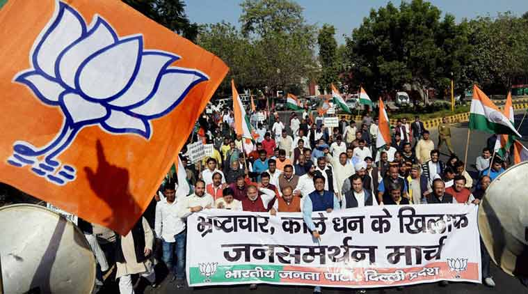 BJP leaders during party's Sankalp March for fight against black money & corrupation, in New Delhi on Friday. (PTI Photo)