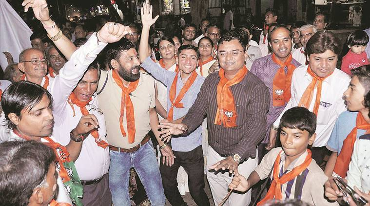 BJP workers celebrate in Surat on Tuesday. PTI