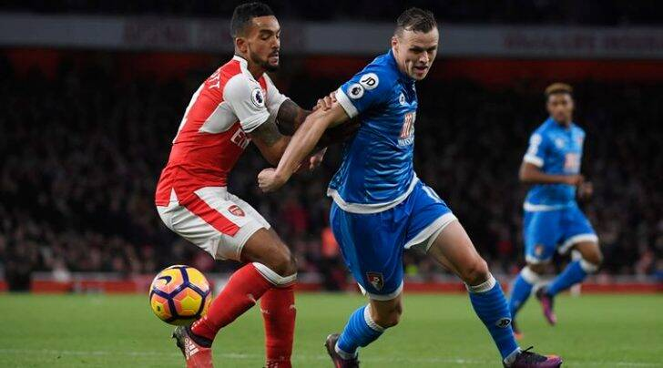 Arsenal's Theo Walcott in action with Bournemouth's Brad Smith