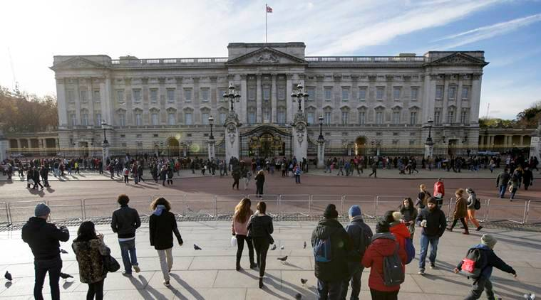 People take pictures in front of Buckingham Palace which is due for a significant taxpayer-funded renovation, London, Friday Nov. 18, 2016. Queen Elizabeth II's home in London needs urgent infrastructure work to fix plumbing, electrical cables and heating that hasn't been upgraded since World War II. (AP Photo/Tim Ireland)