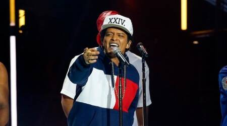 "FILE - In this Nov. 6, 2016 file photo, Bruno Mars performs during the MTV European Music Awards 2016, in Rotterdam, Netherlands. Mars' newest album, ""24K Magic,"" comes out on Friday, Nov. 18. (AP Photo/Peter Dejong, File)"