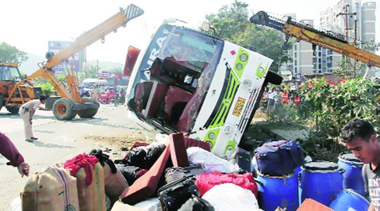 bus accident, pune bus accident, two pilgrims dead, 40 pilgrims injured, tourist bus meets with an accident, indian express news