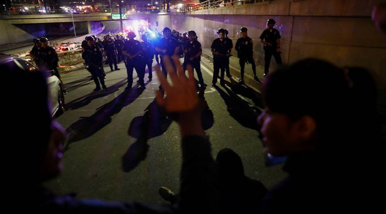 Demonstrators form a line in front of police at a highway ramp after a take over of the Hollywood 101 Freeway in protest against the election of Republican Donald Trump as President of the United States in Los Angeles, California, U.S. November 10, 2016. REUTERS/Patrick T. Fallon