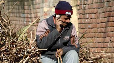 A villager talks on his mobile phone at village Lank in Shamli (UP). *** Local Caption *** A villager talks on his mobile phone at village Lank in Shamli (UP). Express photo by RAVI KANOJIA. Uttar Pradesh Dec 15th-2010