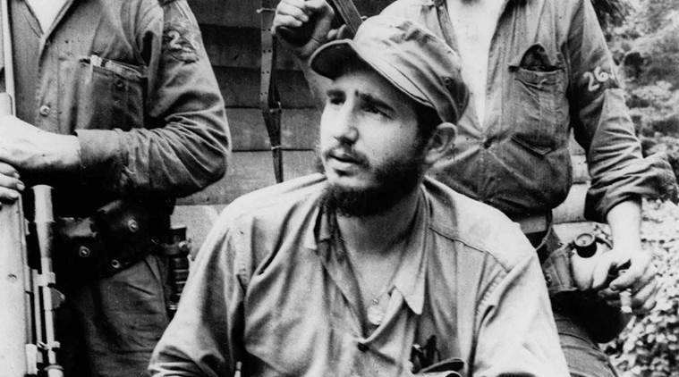 FILE - In this March 14, 1957 file photo, Fidel Castro, the young anti-Batista guerrilla leader, center, is seen with his brother Raul Castro, left, and Camilo Cienfuegos, right, while operating in the Mountains of Eastern Cuba. Cuban President Raul Castro has announced the death of his brother Fidel Castro at age 90 on Cuban state media on Friday, Nov. 25, 2016. (AP Photo/Andrew St. George, File)