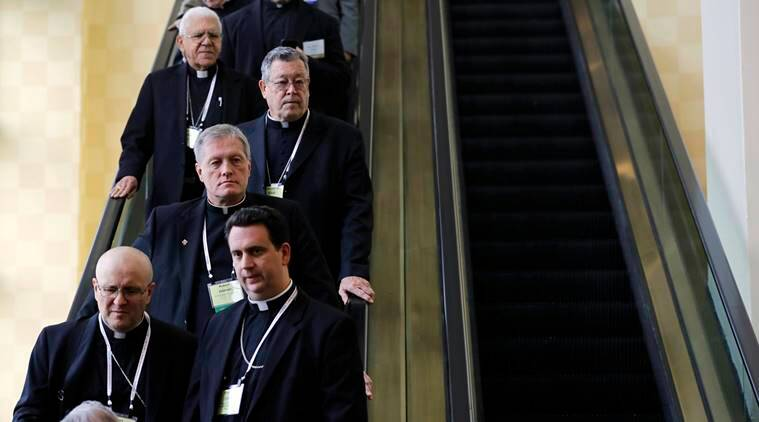 Members of the United States Conference of Catholic Bishops ride an escalator during the USCCB's annual fall meeting in Baltimore, Monday, Nov. 14, 2016. The bishops opened their meeting by urging President-elect Donald Trump to adopt humane policies toward immigrants and refugees. (AP Photo/Patrick Semansky)