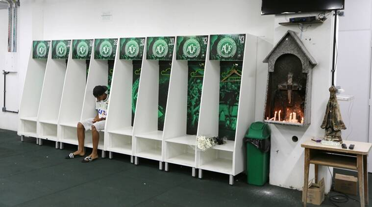 Leandro Bastos player of Chapecoense's under-15 soccer team sits inside the team's locker room at the Arena Conda stadium in Chapeco