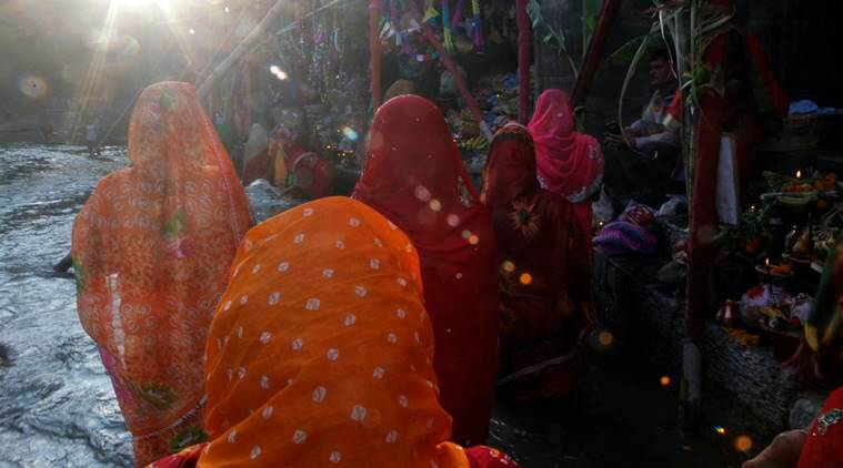 Nepalese women offer prayers on the banks of the Bagmati River during the Chhath Puja festival in Kathmandu, Nepal, Sunday, Nov. 6, 2016. During Chhath, an ancient Hindu festival, rituals are performed to thank the Sun God for sustaining life on earth. (AP Photo/Niranjan Shrestha)