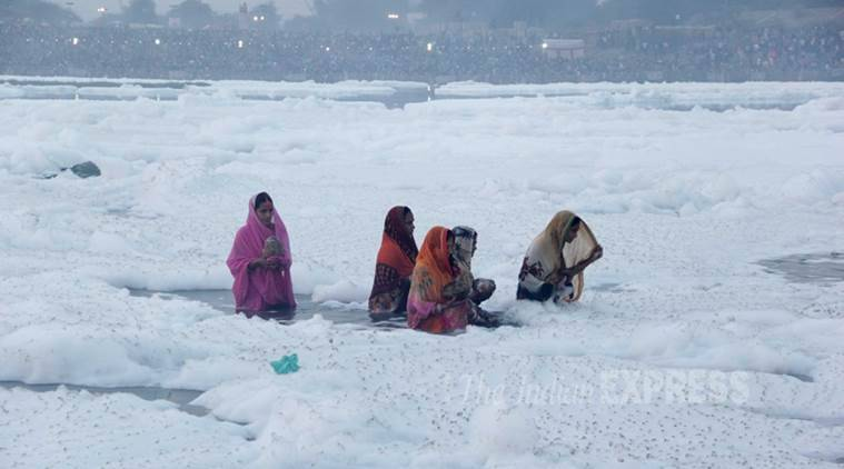 Women take a dip in the Yamuna on the occasion of Chhath Puja. (Source: Express Photo by Gajendra Yadav)