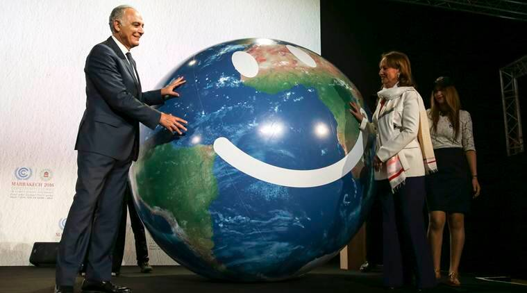 Climate conference president Salaheddine Mezouar and French Environment Minister Segolene Royal, right, stand next to a globe during the opening session of the Climate Conference in Marrakech, Morocco, Monday Nov. 7, 2016. Climate negotiators have started work on implementing the Paris pact on global warming amid uncertainty over how the U.S. election will impact the landmark deal as temperatures and greenhouse gases soar to new heights. (AP Photo/Mosa'ab Elshamy)