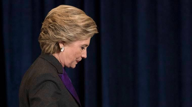 Democratic presidential candidate Hillary Clinton walks off the stage after speaking in New York, Wednesday, Nov. 9, 2016. Clinton conceded the presidency to Donald Trump in a phone call early Wednesday morning, a stunning end to a campaign that appeared poised right up until election day to make her the first woman elected U.S. president. (AP Photo/Matt Rourke)