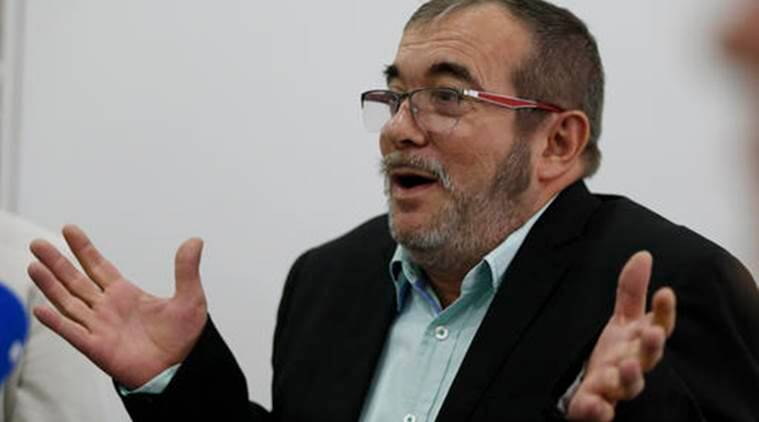 Rodrigo Londono, top leader of the Revolutionary Armed Forces of Colombia, FARC, speaks during a roundtable with foreign journalists in Bogota, Colombia, Friday, Nov. 25, 2016, a day after he signed a second, modified peace accord with Colombia's President Juan Manuel Santos to end the country's half-century conflict. (AP Photo/Fernando Vergara)