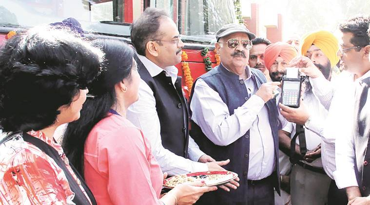 UT Administrator V P Singh Badnore launches Electronic Ticketing Machines at Punjab Raj Bhavan in Chandigarh on Monday. Express
