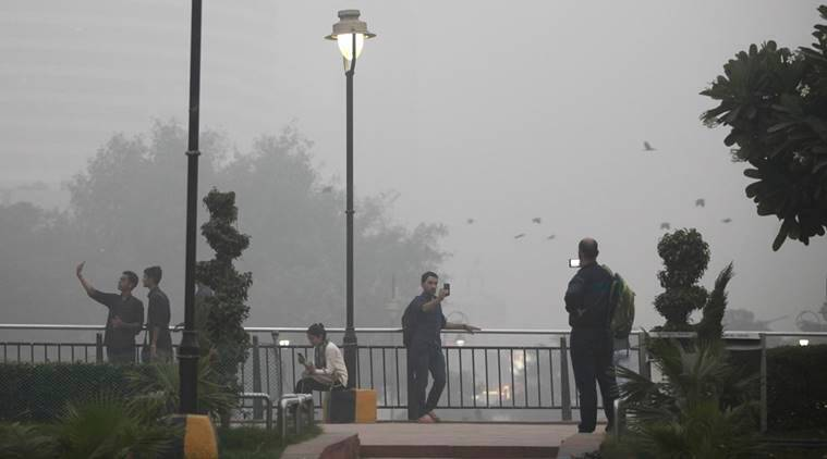 Indians take selfies at a public park enveloped by thick smog in New Delhi, India, Saturday, Nov. 5, 2016. According to one advocacy group, government data shows that the smog that enveloped New Delhi this past week was the worst in the last 17 years. The concentration of PM2.5, tiny particulate pollution that can clog lungs, averaged close to 700 micrograms per cubic meter. That's 12 times the government norm and a whopping 70 times the WHO standards. (AP Photo/Altaf Qadri)