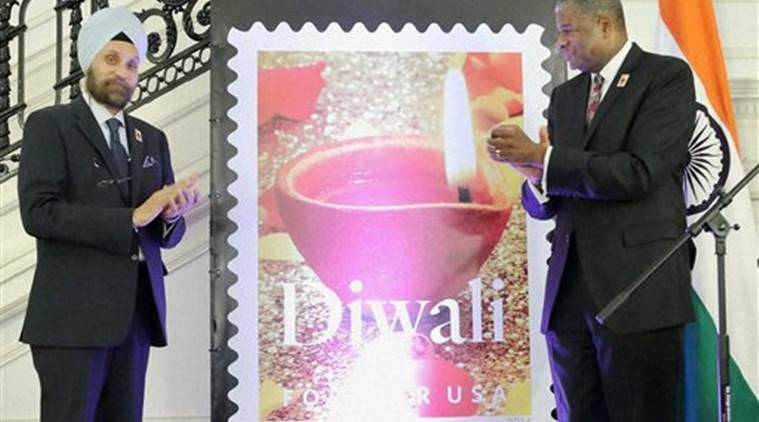 Washington:  Ambassador Navtej Sarna and  US Deputy Postmaster General  Ronald A. Stroman unveil a Diwali stamp at the Diwali Celebration and Diwali Forever Stamp Dedication  event hosted by the Embassy of India in Washington, DC, on Friday. PTI Photo (PTI11_19_2016_000103A)