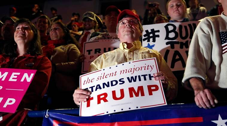People hold signs during a campaign rally for Republican presidential candidate Donald Trump Monday, Nov. 7, 2016, in Scranton, Pa. (AP Photo/Mel Evans)