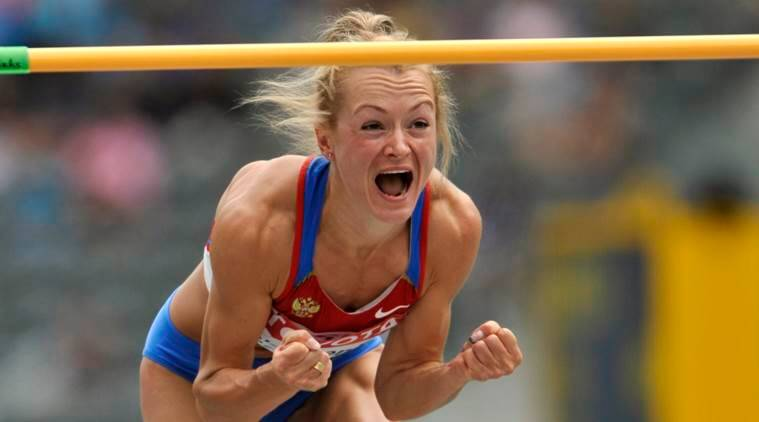 FILE-In this Tuesday, Aug. 18, 2009 file photo Russia's Elena Slesarenko reacts after the Women's High Jump qualification during the World Athletics Championships in Berlin, Germany. The International Olympic Committee on Thursday, Nov. 17, 2016, stripped 10 athletes of medals from the 2008 Olympics after banned substances were found during retests of samples from the games. (AP Photo/Gero Breloer, File)
