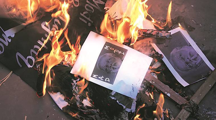 Activists burn effigy of Prime Minister Narendra Modi, protesting against demonetisation of Rs 500 and Rs1,000 currency notes, in Kolkata on Wednesday. Partha Paul