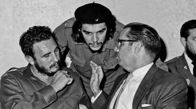 "Ernesto ""Che"" Guevara, center, Cuba's leader Fidel Castro, left, and Cuba's President Osvaldo Dorticos, right, attend a reception in an unknown location in Cuba in 1960. (AP Photo)"