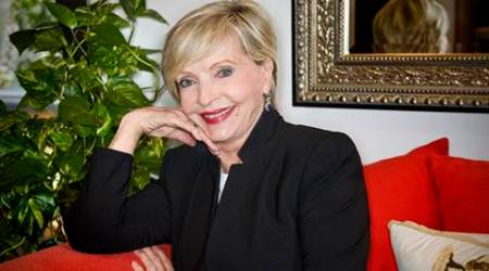 """In this May 2015 photo, actress Florence Henderson spoke during the Alzheimer's Association, Orange County's 9th annual Visionary Women Luncheon at Rancho Las Lomas in Silverado, Calif.  Henderson, the wholesome actress who went from Broadway star to television icon when she became Carol Brady, the ever-cheerful matriarch of """"The Brady Bunch,"""" has died, her manager and her publicist said. She was 82. Henderson died Thursday night, Nov. 24, 2016,  at Cedars-Sinai Medical Center in Los Angeles, after being hospitalized the day before, said her publicist, David Brokaw.  (Nick Agro/The Orange County Register/SCNG via AP)"""