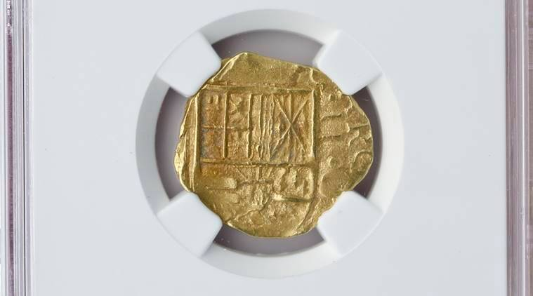 In this Oct. 19, 2016, handout photo photo released by Blanchard and Company, a gold coin from a 300-year-old shipwreck discovered off Florida's coast is displayed in New Orleans. Blanchard and Company is one of two dealers offering the coins from an area where 11 treasure-laden ships of a Spanish fleet were smashed onto reefs by a hurricane on July 31, 1715. The other dealer is California-based Monaco Rare Coins. (Blanchard and Company via AP)