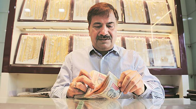 A man counting Rs 1,000 currency notes at a jewellery shop in Mumbai. Prashant Nadkar