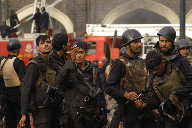Black commandos outside Taj Mahal hotel taking pictures from their cell phones after their rescue operation. Express photo by Ganesh Shirsekar. Mumbai 29/11/08