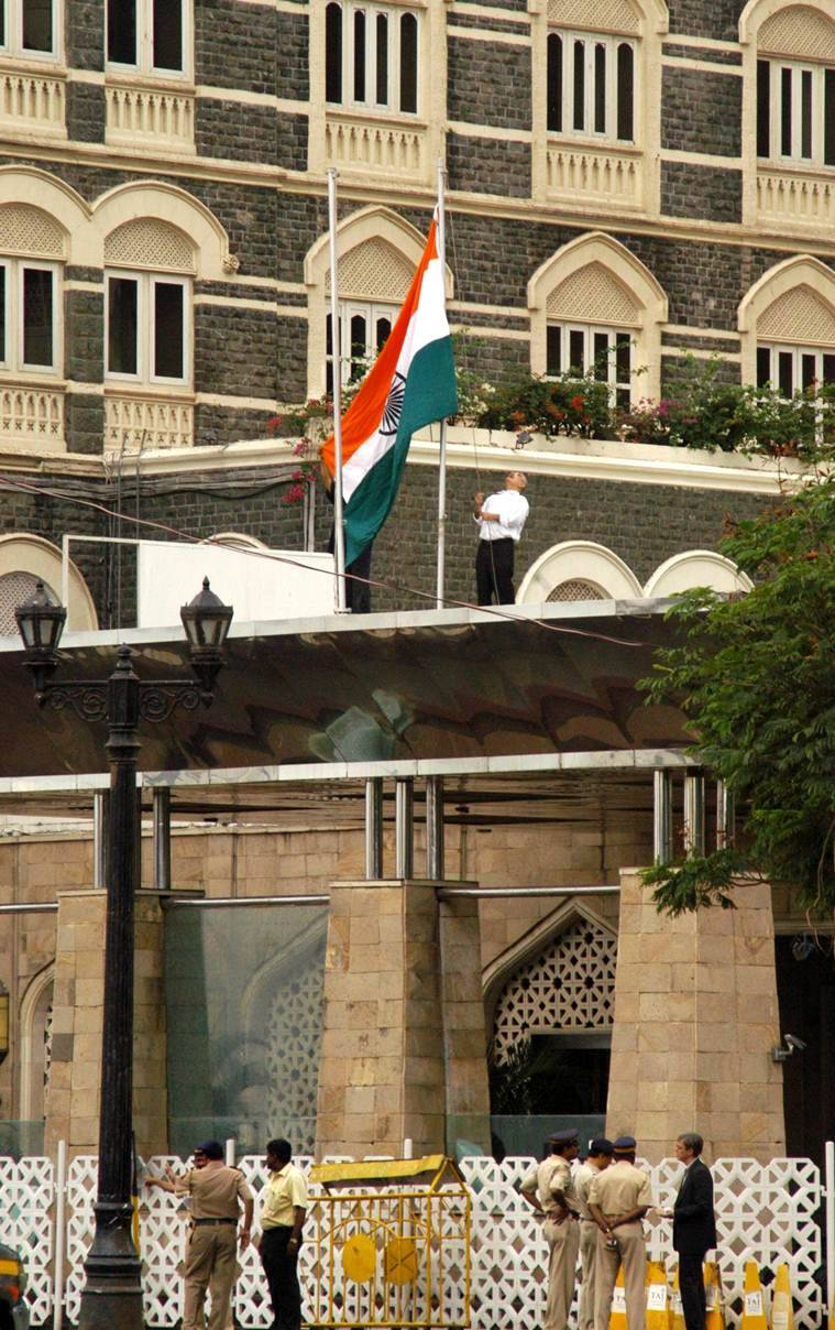 For the first time Taj Mahal Hotel hoist the tricolour Indain flag post militant attack on Sunday. Express Photo by Ganesh Shirsekar, Mumbai, 30/11/2008