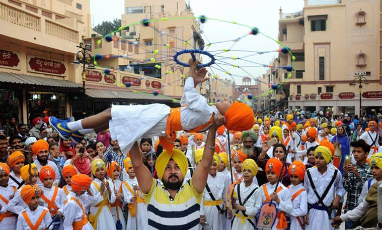 Amritsar: A Sikh boy performs 'Gatka' during Nagar Kirtan procession near the Golden Temple on the 548th birth anniversary of Guru Nanak Dev in Amritsar on Saturday. PTI Photo(PTI11_12_2016_000092A)
