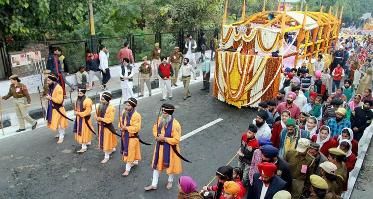 Jammu: Panj Pyare lead a procession on the occasion of the 548th birth anniversary of Guru Nanak Dev in Jammu on Saturday. PTI Photo(PTI11_12_2016_000129A)