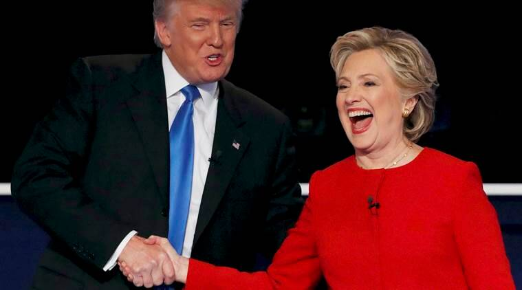 Republican US presidential nominee Donald Trump shakes hands with Democratic US presidential nominee Hillary Clinton at the conclusion of their first presidential debate at Hofstra University in Hempstead, New York. Clinton can be seen in a Ralph Lauren suit. (Source: Reuters)