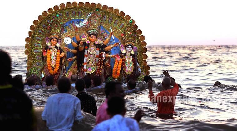 Durga Idol Immersion At Juhu Beach Mumbai on Tuesday. Express Photo By Pradip Das,11th Oct 2016,Mumbai.