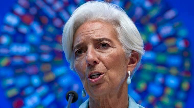 FILE - In this Oct. 8, 2016 file photo, International Monetary Fund (IMF) Managing Director Christine Lagarde speaks during a news conference in Washington. On Monday, Nov. 7, 2016, Lagarde called on governments and businesses to do more to promote the same economic opportunities for men and women and to fight discrimination that interferes with those goals. (AP Photo/Jose Luis Magana, File)