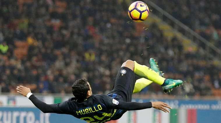 Inter Milan's Jeison Murillo goes for an acrobatic kick during the Serie A soccer match between Inter Milan and Crotone at the San Siro stadium in Milan, Italy, Sunday, Nov. 6, 2016. (AP Photo/Antonio Calanni)