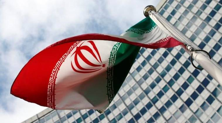 An Iranian flag flutters in front of the United Nations headquarters. {Source: File/REUTERS photo)