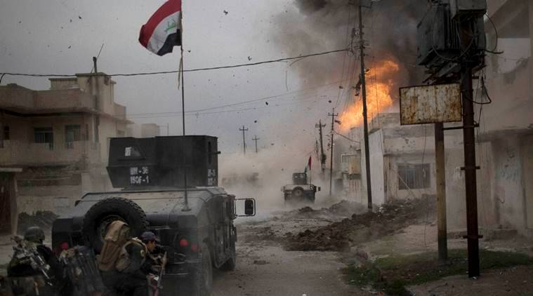 Mosul: A car bomb explodes next to Iraqi special forces armored vehicles as they advance towards Islamic State held territory in Mosul, Iraq, Wednesday, Nov. 16, 2016. AP/PTI(AP11_19_2016_000013B)