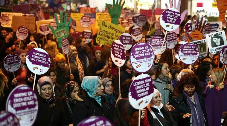 Thousands of Turkish women march to protest against a law project by the government, in Istanbul, Friday, Nov. 25, 2016.  Following a public outcry, Turkey's government on Tuesday has withdrawn a proposal that critics said would have allowed men accused of sexually abusing underage girls to go free if they were married to their victims. (AP Photo/Emrah Gurel)