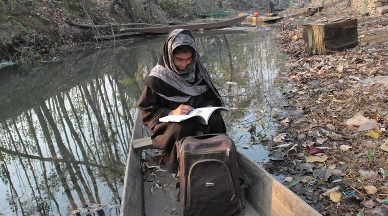 Peer Learning:-A Female student while sitting in shakara in north kashmir's  Bandipora preparing for secondary school examination to be held in kashmir valley from mid November Amid shutdown .Express Photo by Shuaib Masoodi 07-11-2016