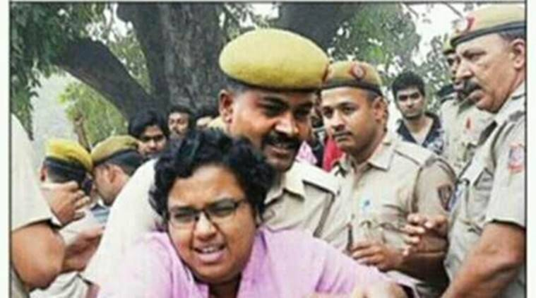 This picture of a JNU student being manhandled by the cop is being massively shared on social media/ Twitter