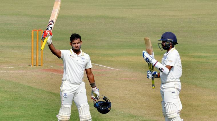 Nagpur: Tamil Nadu batsman Kaushik Gandhi celebrates after scoring 150 runs against Punjab during the 3rd day of the Ranji Trophy cricket match at VCA stadium in Nagpur on Wednesday. PTI Photo  (PTI11_23_2016_000177A)