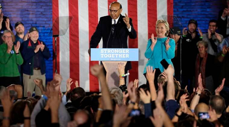 Khizr Khan, left, a Gold Star father, whose son Army Captain Humayun Khan was killed in Iraq saving his fellow soldiers, speaks during a campaign rally for Democratic presidential candidate Hillary Clinton, right, Sunday, Nov. 6, 2016, in Manchester, N.H. (AP Photo/Steven Senne)