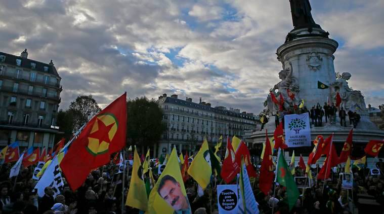 Kurdish demonstrators hold flags during a rally to protest against Turkish President Recep Tayyip Erdogan, at Republique Square in Paris, Saturday, Nov. 5, 2016. Authorities in Turkey detained 11 pro-Kurdish Peoples' Democratic Party (HDP) lawmakers early Friday as part of ongoing terror-related investigations, including both party co-chairs Selahattin Demirtas and Figen Yuksekdag and other senior officials, the Interior Ministry said. (AP Photo/Francois Mori)
