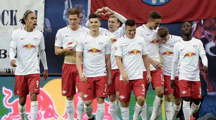 Leipzig players celebrate after scoring during the German first division Bundesliga soccer match between RB Leipzig and 1. FSV Mainz 05 in Leipzig, Germany, Sunday, Nov. 6, 2016. (AP Photo/Jens Meyer)