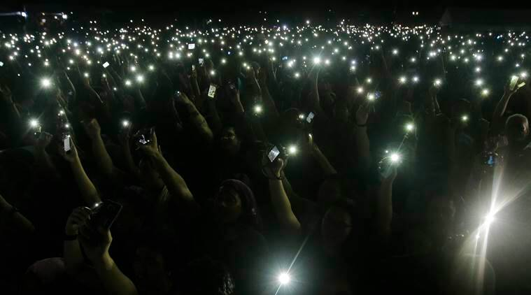 Protesters use their smartphones as part of an activity during a rally at Manila's Rizal Park, Philippines Friday Nov. 25, 2016 against the hasty burial of Philippine dictator Ferdinand Marcos in a heroes' cemetery. Thousands of Filipinos, including more than a dozen nude students, have protested the hasty burial of Marcos in a heroes' cemetery in a growing political storm that's lashing Philippine President Rodrigo Duterte who allowed the entombment. (AP Photo/Aaron Favila)