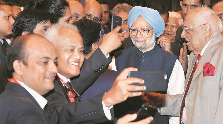 Businessmen take selfies with former Prime Minister Manmohan Singh during the valedictory session of PHD Chambers's 111th annual session in New Delhi on Saturday. PTI
