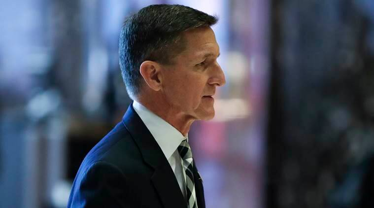 Retired Lt. Gen Michael Flynn walks through the lobby at Trump Tower, Thursday, Nov. 17, 2016, in New York. (AP Photo/Carolyn Kaster)